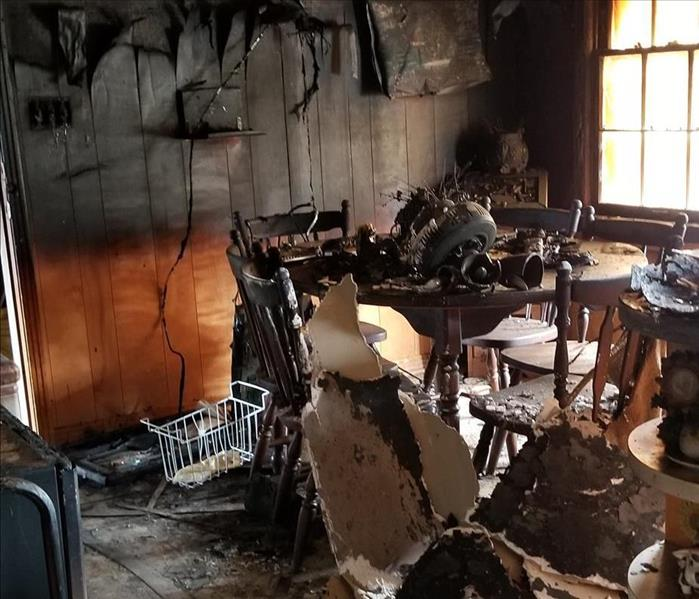 Dining room affected by fire and smoke damage